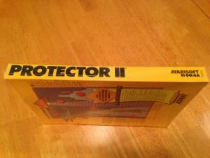 Protector II™, Packaging Left Side Atarisoft RX 8516, TI-99/4A © 1983 Atari, Inc.